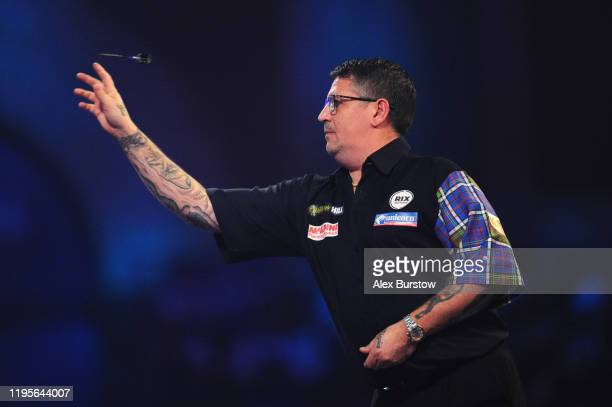 Gary Anderson of Scotland in action against Ryan Searle of England in his Third Round match during Day Eleven of the 2020 William Hill World Darts...