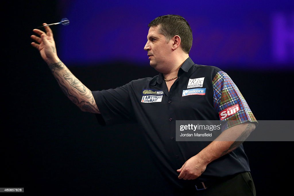 Gary Anderson of Scotland in action during his second round match against Jelle Klaasen of the Netherlands during Day Seven of the William Hill PDC World Darts Championships at Alexandra Palace on December 27, 2014 in London, England.