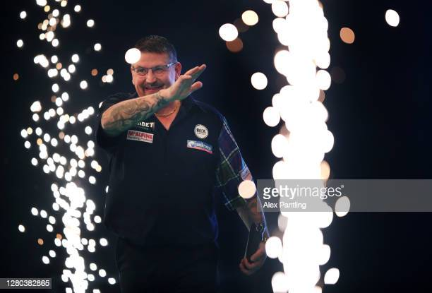 Gary Anderson of Scotland makes his way out for his semi-final match against Glen Durrant of England during the Unibet Premier League Play-Offs at...