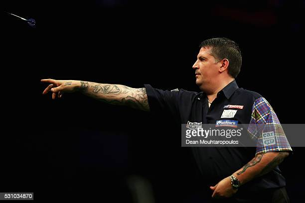 Gary Anderson of Scotland plays a shot in his match against Adrian Lewis of England during the Darts Betway Premier League Night 15 at Rotterdam Ahoy...
