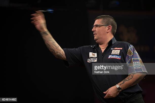 Gary Anderson of Scotland plays a shot in his semifinal match against James Wade of England during the SINGHA Beer Grand Slam of Darts at...