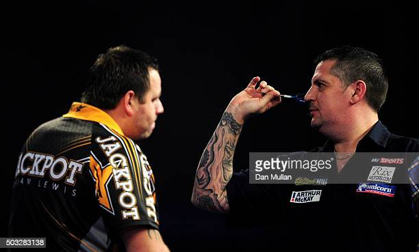 Gary Anderson of Scotland prepares to throw during the final match against Adrian Lewis of England during Day Fifteen of the 2016 William Hill PDC...