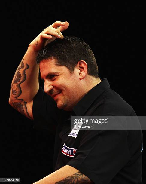 Gary Anderson of Scotland reacts during his match against Andy Smith of England during day 12 in the 2011 Ladbrokescom World Darts Championship at...