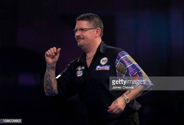 Gary Anderson of Scotland reacts during the 2019 William Hill World Darts Championship SemiFinal match between Michael van Gerwen and Gary Anderson...