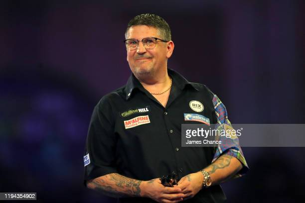 Gary Anderson of Scotland reacts during the Second Round match between Gary Anderson and Brendan Dolan on Day 4 of the 2020 William Hill World Darts...