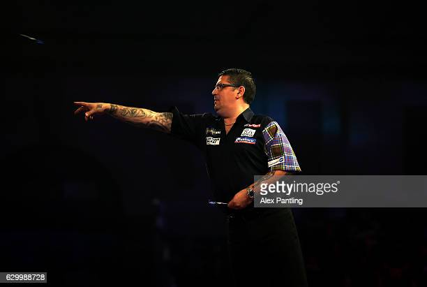 Gary Anderson of Scotland throws during his first round match against Mark Frost of England during day one of the 2017 William Hill PDC World Darts...