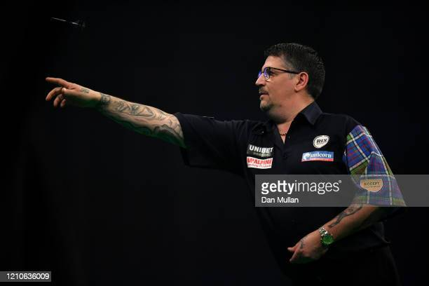 Gary Anderson of Scotland throws during his match against Luke Humphries of England during Night Five of the Premier League Darts at Westpoint on...