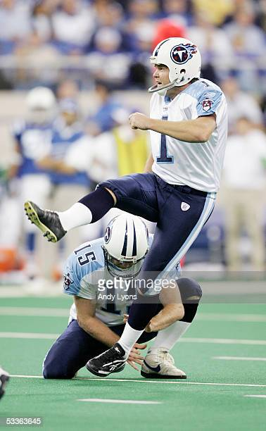 Gary Anderson of the Tennessee Titans attempts a field goal from the hold of Craig Hentrich during the game against the Indianapolis Colts at the RCA...