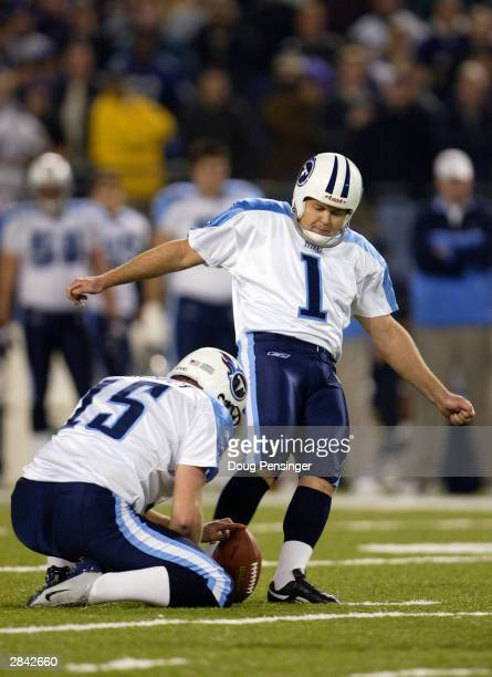 Gary Anderson of the Tennessee Titans connects on a 46 yard gamewinning field goal as Craig Hentrich holds as the Titans defeated the Baltimore...