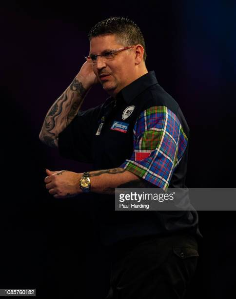 Gary Anderson reacts during his third round match against Jermaine Wattimena during Day 10 of the 2019 William Hill World Darts Championship at...