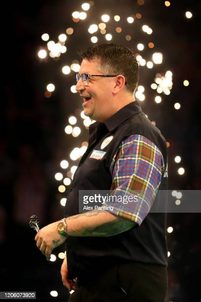 Gary Anderson reacts following his match against Peter Wright during day two of the Unibet Premier League at Motorpoint Arena on February 13 2020 in...