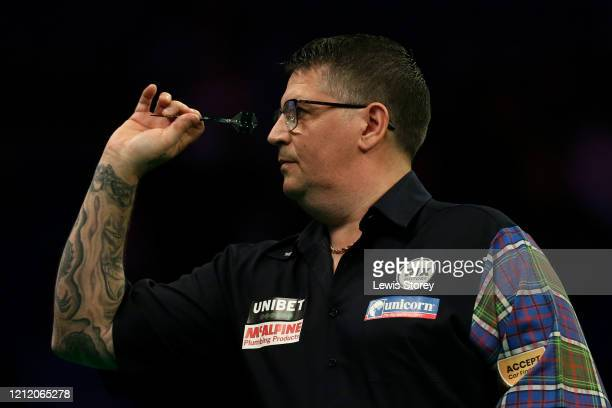 Gary Anderson throws a dart in his match against Nathan Aspinall during Night Six of the Premier League Darts at the MS Bank Arena on March 12 2020...
