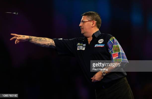 Gary Anderson throws during his third round match against Jermaine Wattimena during Day 10 of the 2019 William Hill World Darts Championship at...