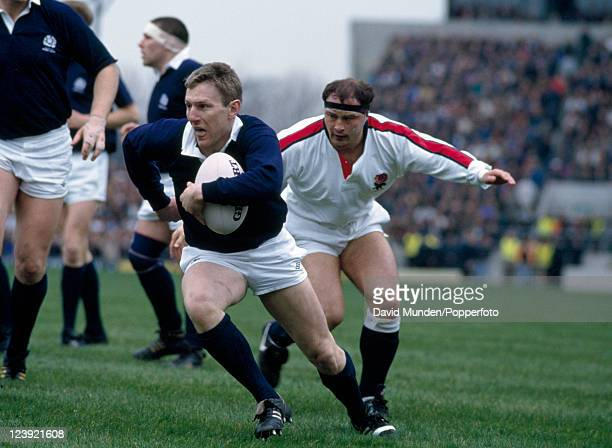 Gary Armstrong of Scotland moves away from Brian Moore of England during the Rugby Union International at Twickenham in London on the 6th March 1993...