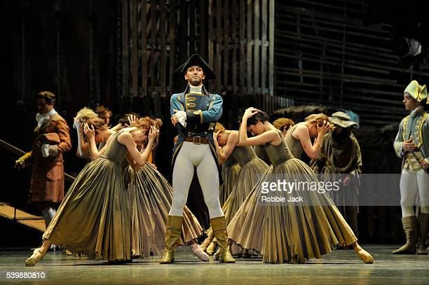 Gary Avis as The Goaler with artists of the company in the Royal Ballet's production of Kenneth MacMillan's Manon at the Royal Opera House Covent...