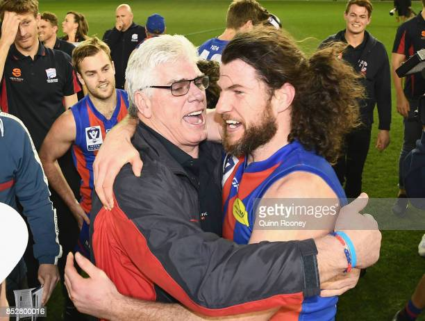 Gary Ayres and Toby Pinwill of Port Melbourne celebrate winning the VFL Grand Final match between Richmond and Port Melbourne at Etihad Stadium on...
