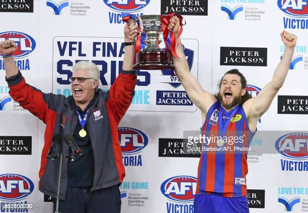 Gary Ayres coach of Port Melbourne and captain Toby Pinwill celebrate with the trophy during the VFL Grand Final match between Richmond and Port...