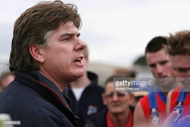 Gary Ayres coach of Port Melbourne talks to his players during the round 14 VFL match between Port Melbourne and North Ballarat at TEAC Oval on July...