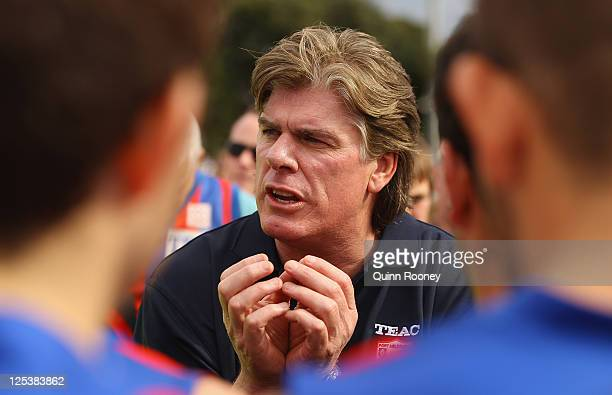 Gary Ayres the coach of Port Melbournetalks to his players during the VFL preliminary Final match between Port Melbourne and Northern Bullants at...