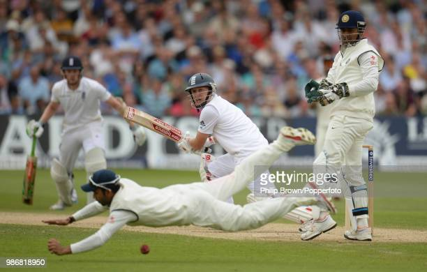 Gary Ballance of England plays the ball past a diving Ajinkya Rahane of India during the 1st Test match between England and India at Trent Bridge...