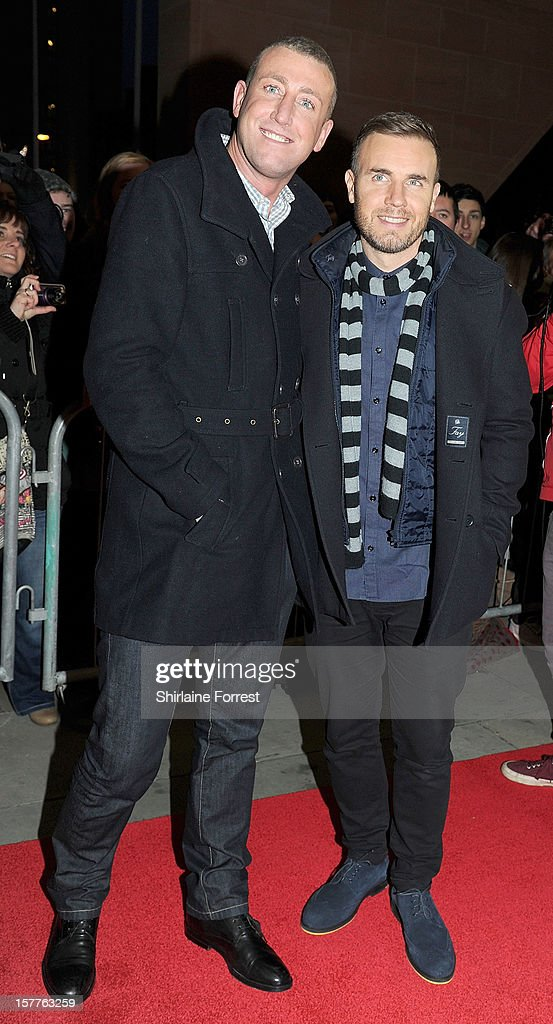 Gary Barlow (R) and Christopher Maloney attend a press conference ahead of the X Factor final this weekend at Manchester Conference Centre on December 6, 2012 in Manchester, England.