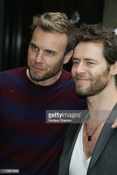 Gary Barlow and Howard Donald arrive at the the 53rd Ivor Novello Awards held at the Grosvenor House on May 22 2008 in London England