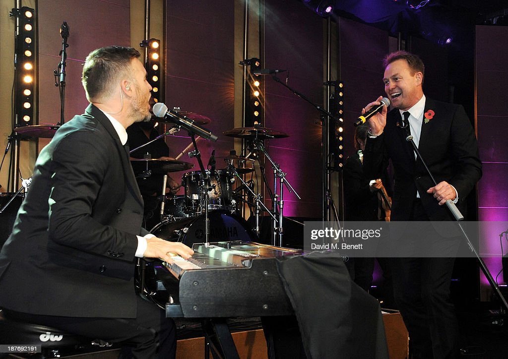 Gary Barlow (L) and Jason Donovan perform at the BBC Children in Need Gala hosted by Gary Barlow at The Grosvenor House Hotel on November 11, 2013 in London, England.