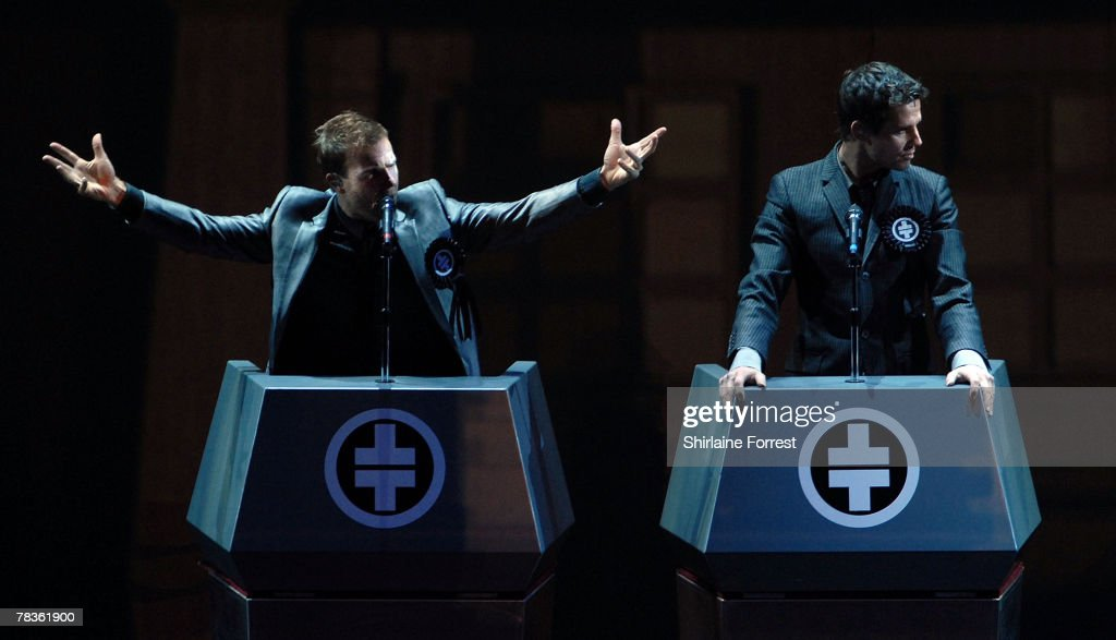 Gary Barlow and Jason Orange of Take That perform at Manchester Arena on December 10, 2007 in Manchester, England.