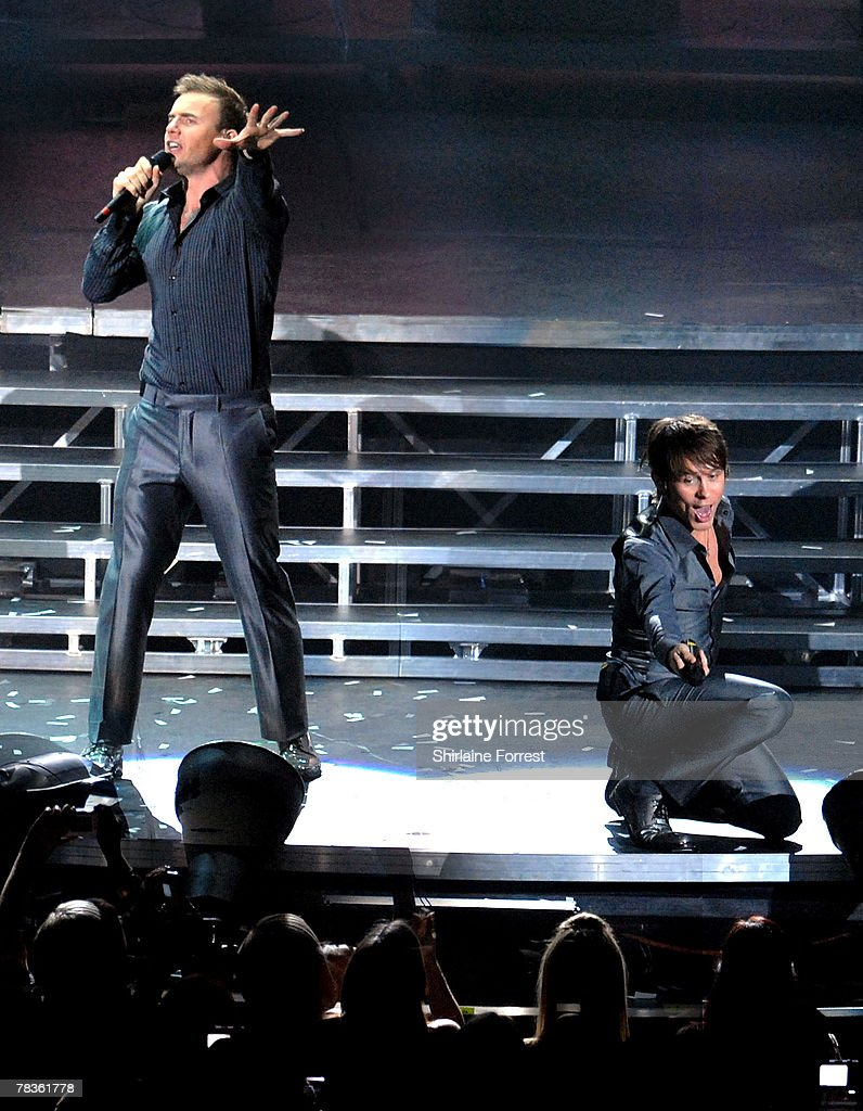 Gary Barlow and Mark Owen of Take That perform at Manchester Arena on December 10, 2007 in Manchester, England.