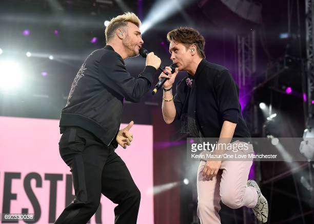 Gary Barlow and Mark Owen of Take That perform on stage during the One Love Manchester Benefit Concert at Old Trafford Cricket Ground on June 4 2017...