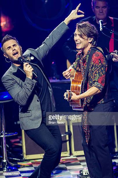 Gary Barlow and Mark Owen perform during the 2015 Apple Music Festival at The Roundhouse on September 20 2015 in London England