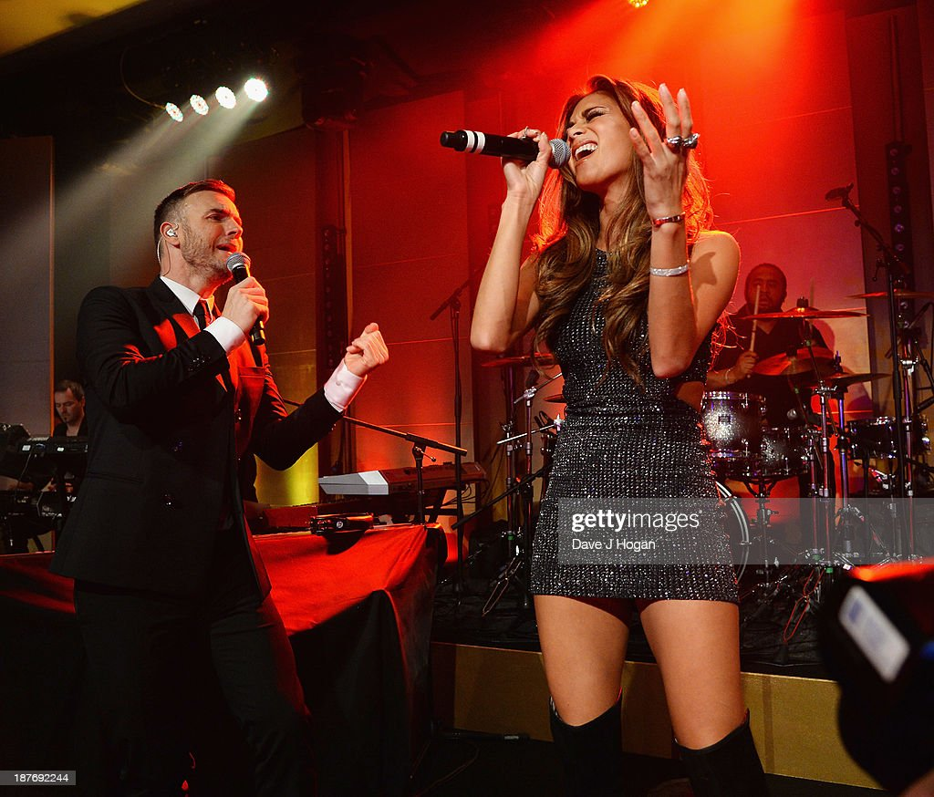 Gary Barlow and Nicole Scherzinger perform as Gary Barlow hosts BBC Children In Need Gala at The Grosvenor House Hotel on November 11, 2013 in London, England.