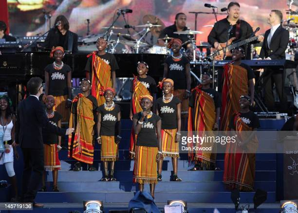 Gary Barlow and the Commonwealth band perform on stage during the Diamond Jubilee concert at Buckingham Palace on June 4 2012 in London England For...