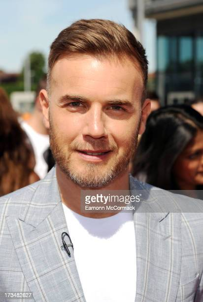 Gary Barlow arrives for the London auditions of The X Factor at Wembley Arena on July 15 2013 in London England