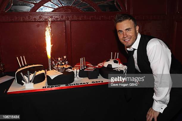 Gary Barlow blows out his birthday cake candles at Gary Barlow's 40th birthday party held at Shepherds Bush Empire on January 20 2011 in London...