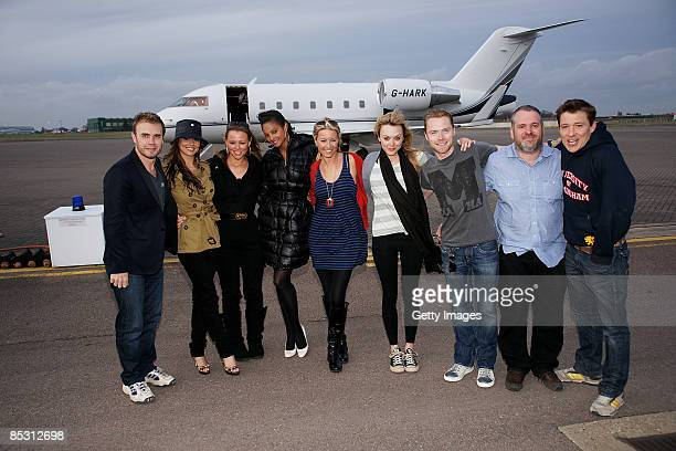 Gary Barlow Cheryl Cole Kimberley Walsh Alysha Dixon Denise Van Outen Fearne Cotton Ronan Keating Chris Moyles and Ben Shepard arrive back in the UK...