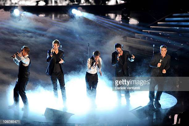 Gary Barlow Howard Donald Jason Orange Mark Owen and Robbie Williams of the Brisish band 'Take That' perform the 61th Sanremo Song Festival at the...