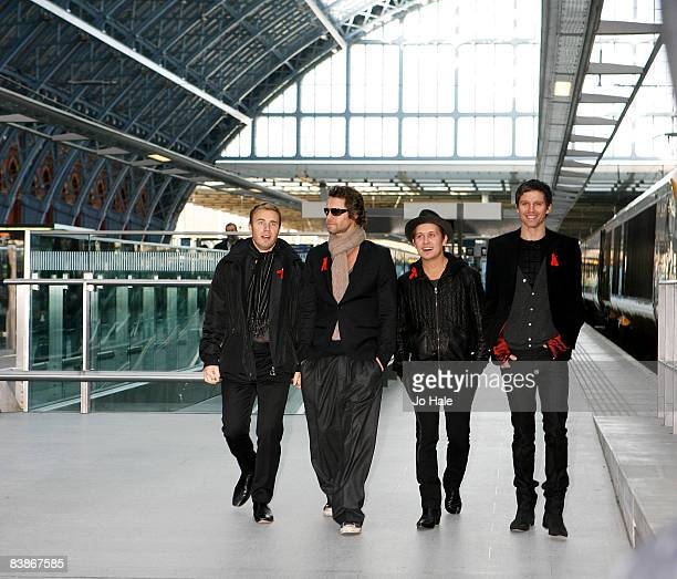 Gary Barlow Howard Donald Mark Owen and Jason Orange of Take That pose before boarding the Eurostar en route to the launch party for their new album...