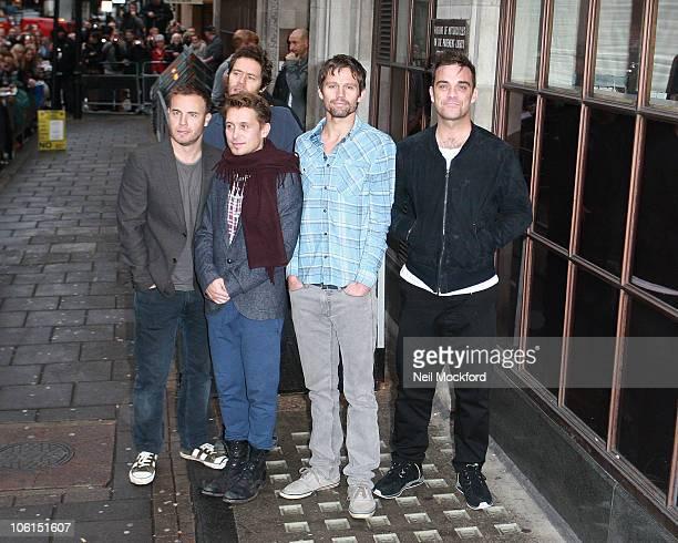 Gary Barlow, Howard Donald, Mark Owen, Jason Orange and Robbie Williams of Take That, visits BBC Radio 1 on October 27, 2010 in London, England.