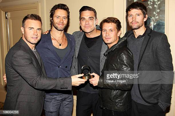 Gary Barlow Howard Donald Robbie Williams Mark Owen and Jason Orange of Take That pose in the press room at the Q Awards 2010 held at The Grosvenor...