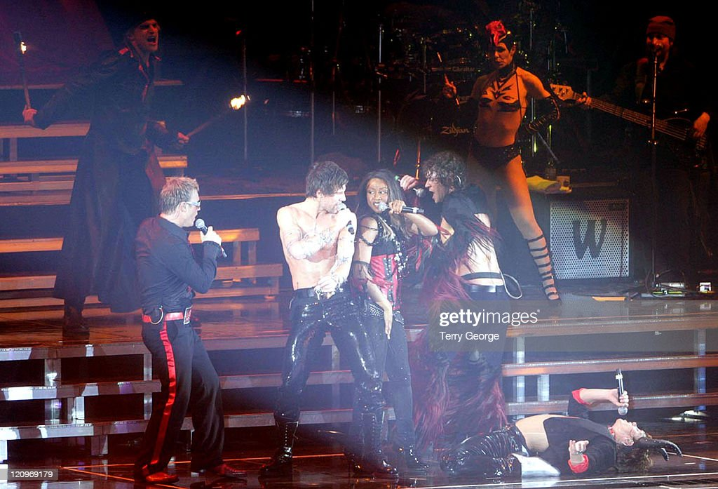 Gary Barlow, Jason Orange and Howard Donald of Take That perform with Beverley Knight