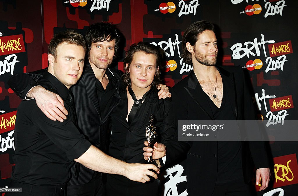 Gary Barlow, Jason Orange, Mark Owen and Howard Donald of Take That pose in the awards room after winning the award for best British Single at the BRIT Awards 2007 in association with MasterCard at Earls Court on February 14, 2007 in London. The winner was chosen by radio and TV viewing audience live on show night.