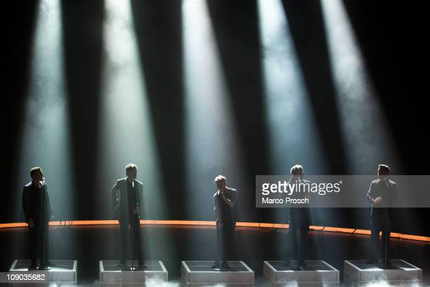 Gary Barlow, Jason Orange, Mark Owen, Howard Donald and Robbie Williams of Take That perform during the 193th 'Wetten, Dass...?' show at the Messe...