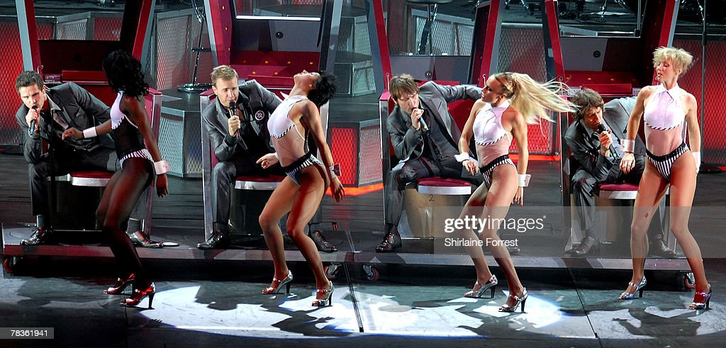 Gary Barlow, Mark Owen, Jason Orange and Howard Donald of Take That perform at Manchester Arena on December 10, 2007 in Manchester, England.