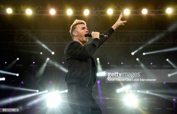 Gary Barlow of Take That performs on stage during the One Love Manchester Benefit Concert at Old Trafford Cricket Ground on June 4 2017 in Manchester...