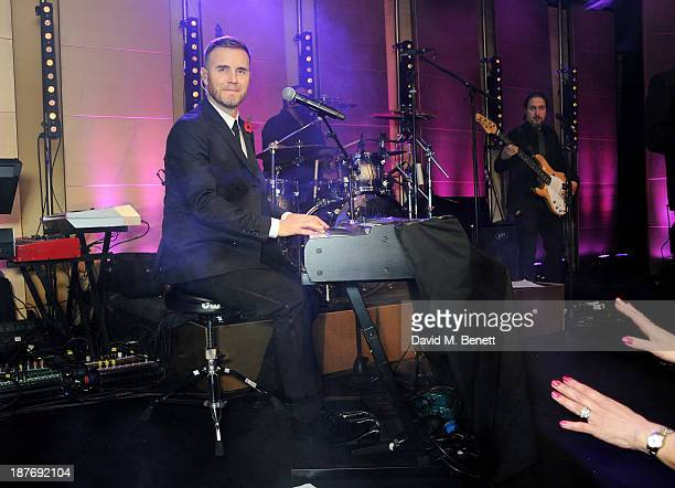 Gary Barlow performs at the BBC Children in Need Gala hosted by Gary Barlow at The Grosvenor House Hotel on November 11 2013 in London England