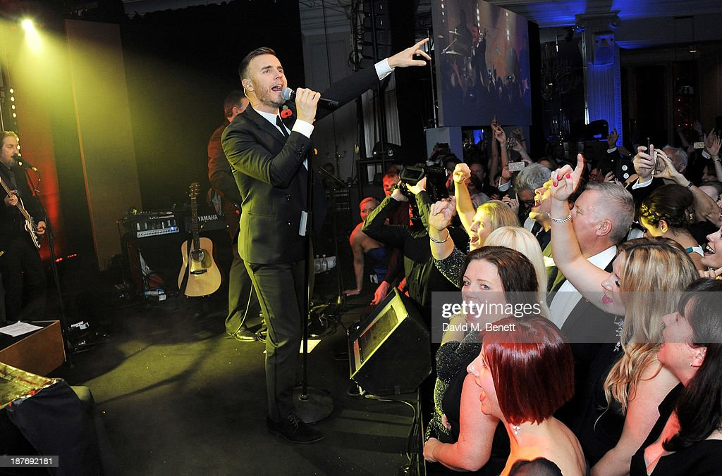 Gary Barlow performs at the BBC Children in Need Gala hosted by Gary Barlow at The Grosvenor House Hotel on November 11, 2013 in London, England.