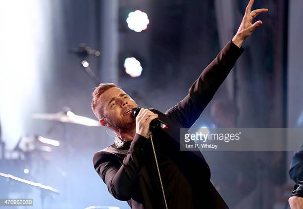 Gary Barlow performs with Take That during a secret gig for Magic FM at One Marylebone on April 24 2015 in London England