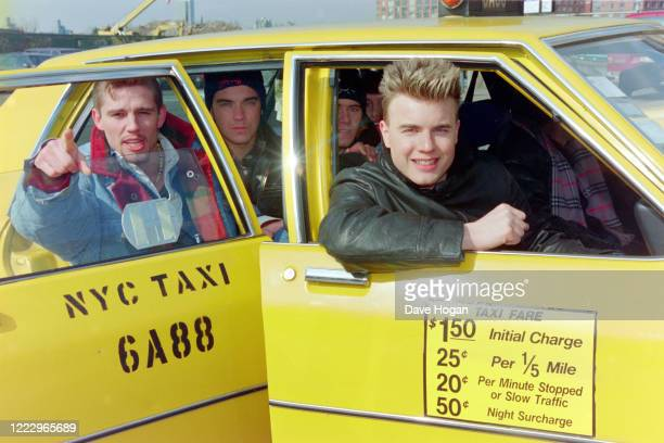 Gary Barlow, Robbie Williams and Jason Orange of Take That in a New York cab, NY, 1995