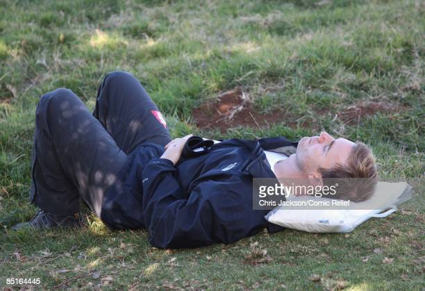 Gary Barlow takes a rest during trekking on the on the first day of The BT Red Nose Climb of Kilimanjaro on March 1 2009 in Arusha Tanzania...